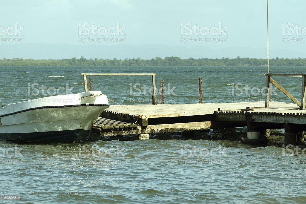 wooden pier and white boat royalty-free stock photo