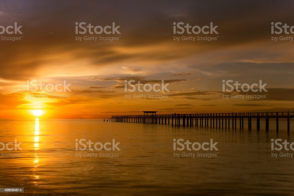 Wooden pier between sunset in Phuket, Thailand stock photo