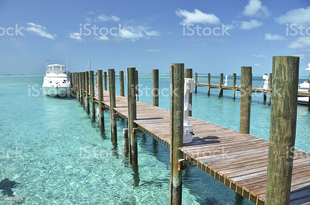 Wooden pier. Exuma, Bahamas stock photo