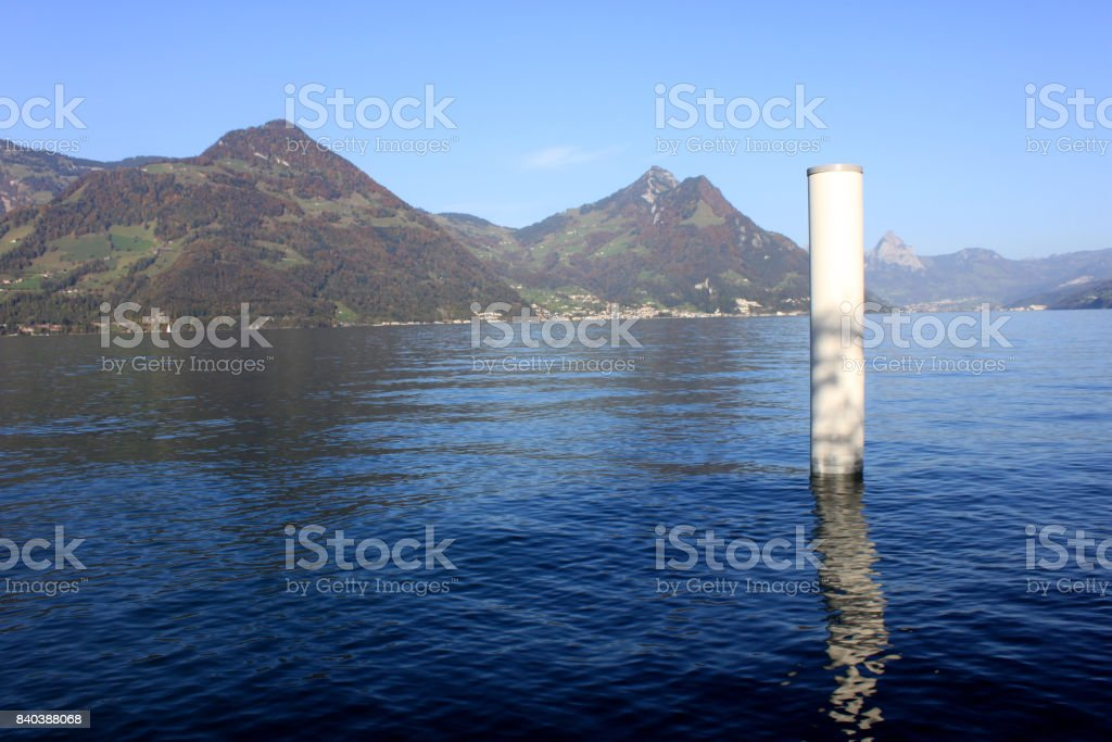 Wooden pier for fixing of boats in a lake stock photo