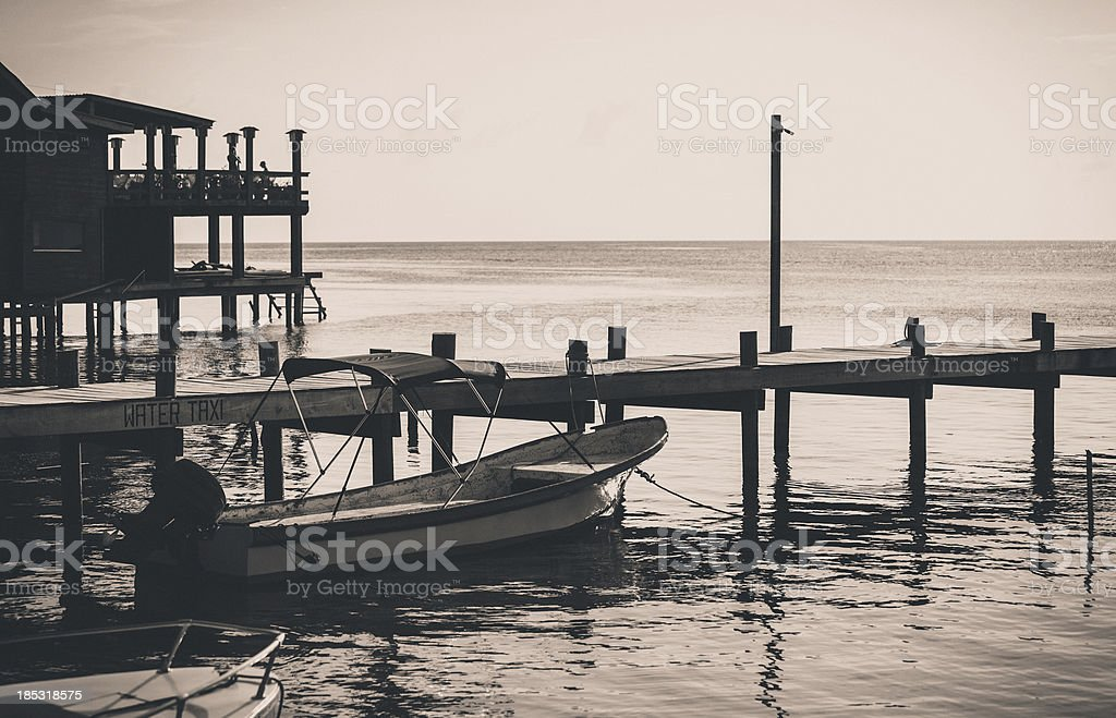 wooden pier in honduras stock photo