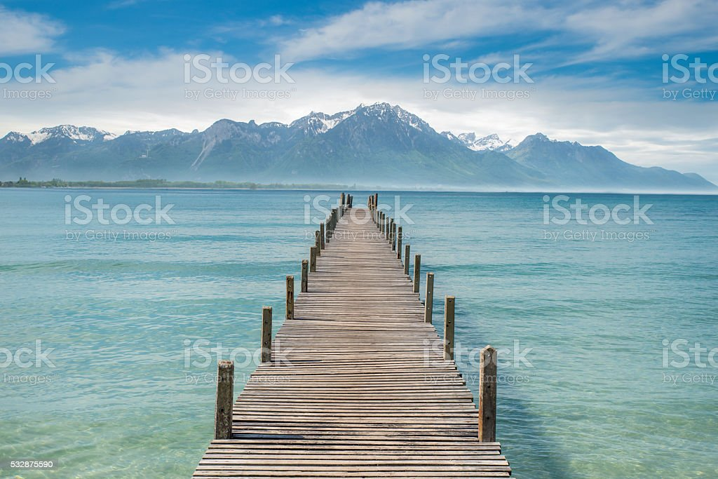 Wooden pier in lake at Switzerland stock photo