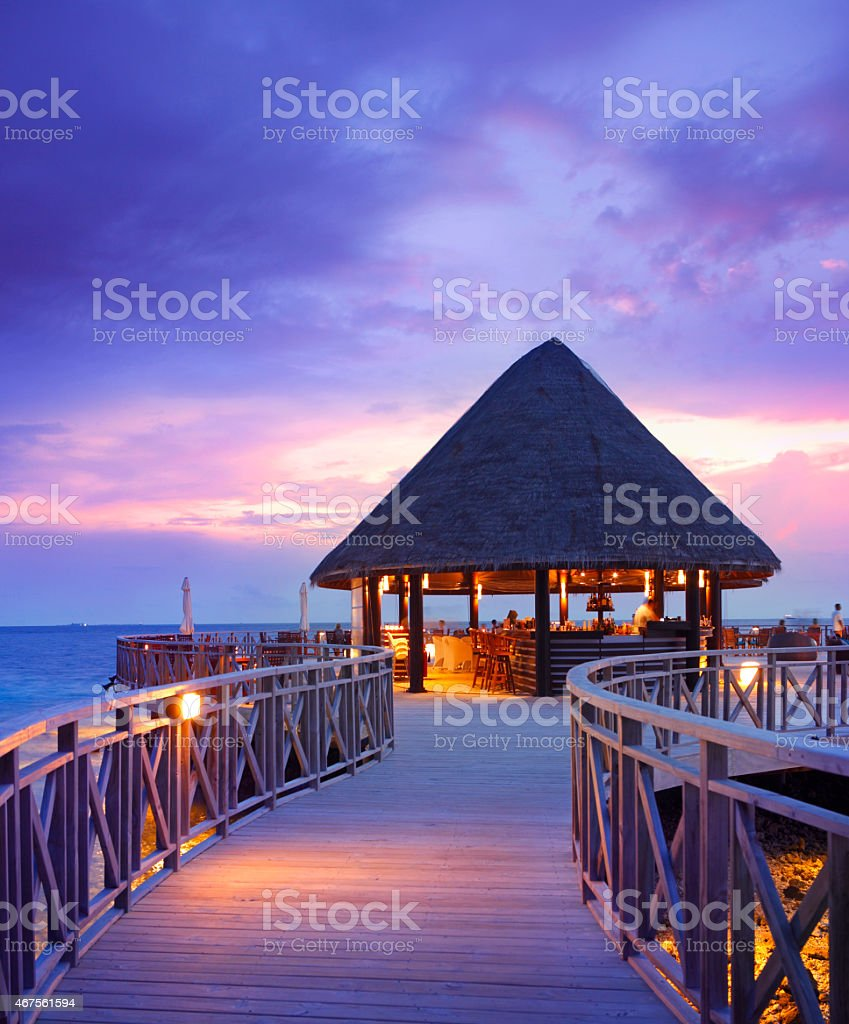 Wooden pier in Maldives by twilight stock photo