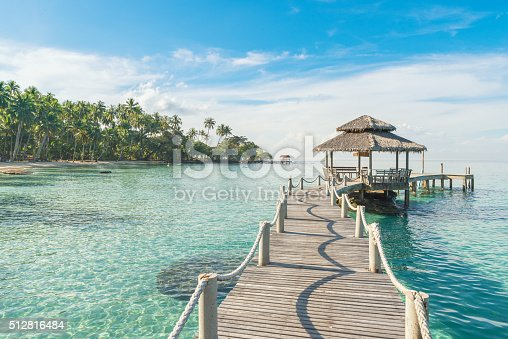 Summer, Travel, Vacation and Holiday concept - Wooden pier in Phuket, Thailand