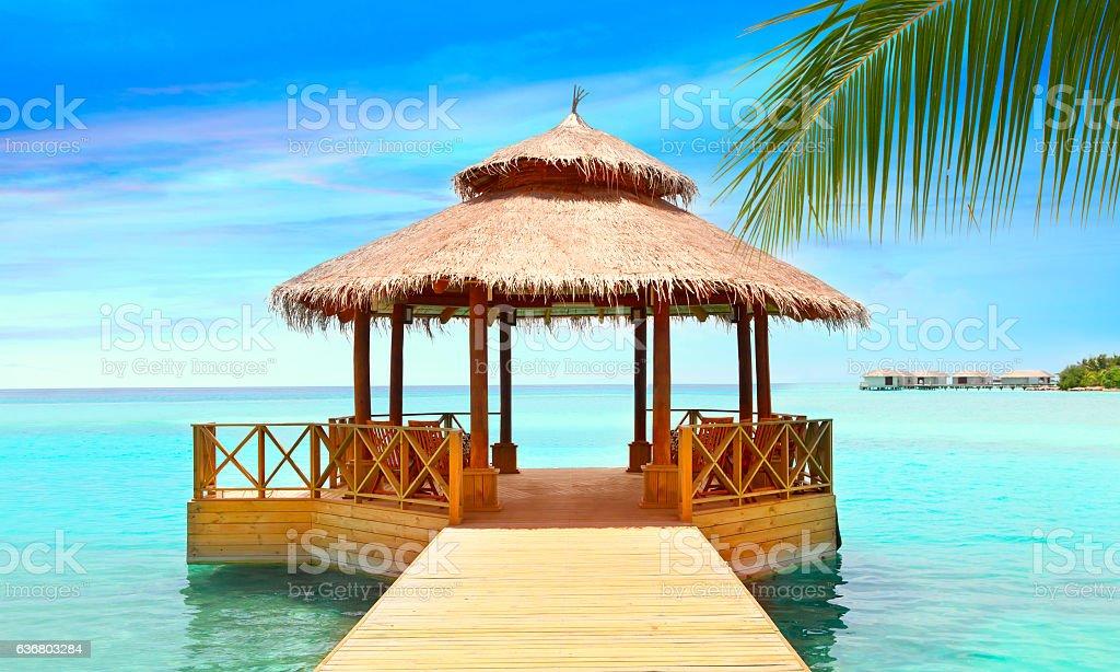 Wooden pier in the sea at Maldives Lizenzfreies stock-foto