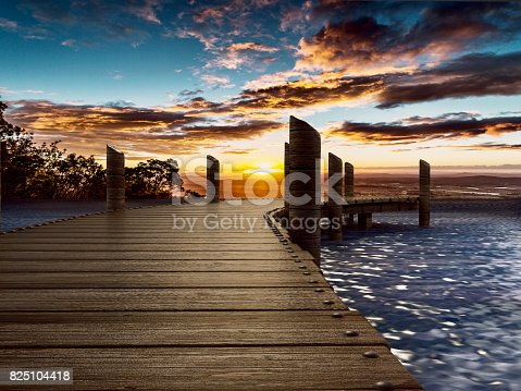 Wooden pier longing trough the blue sea.