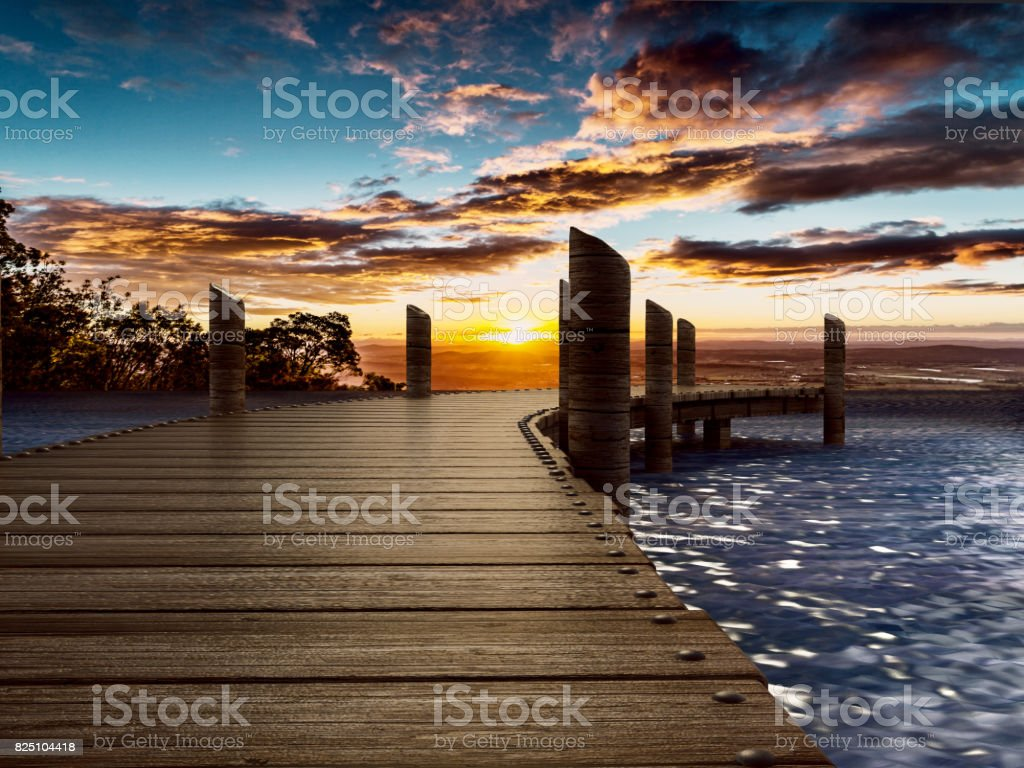 Wooden pier longing trough the blue sea stock photo