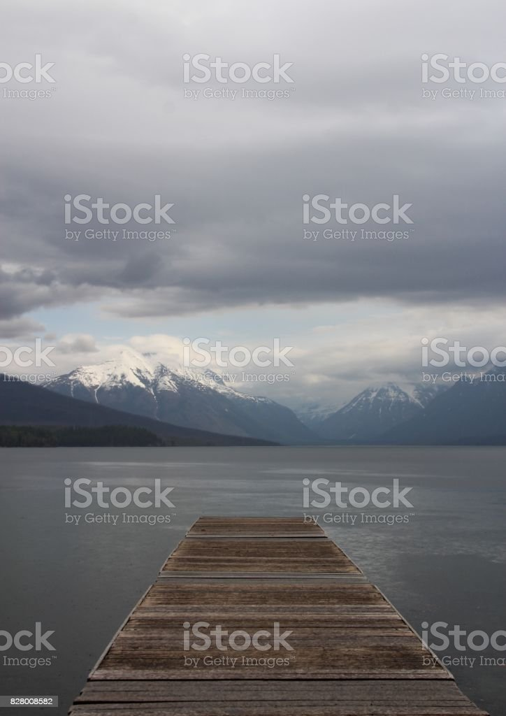 Wooden Pier Overlooking Mountains stock photo