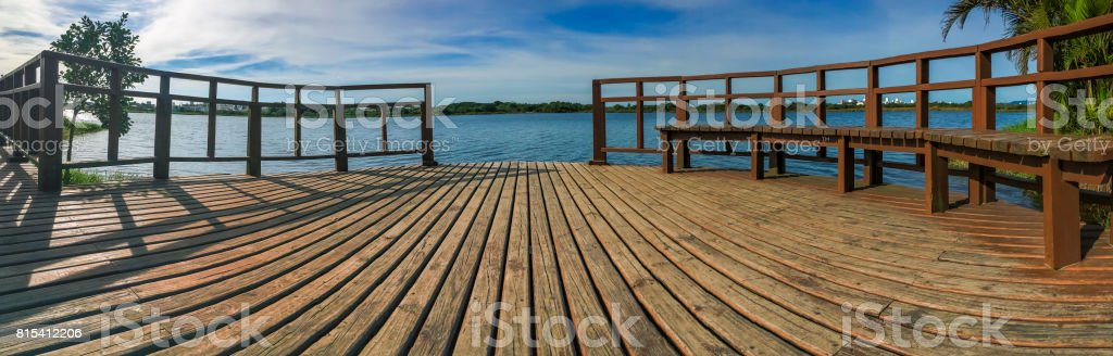Wooden pier panorama on sunny day stock photo