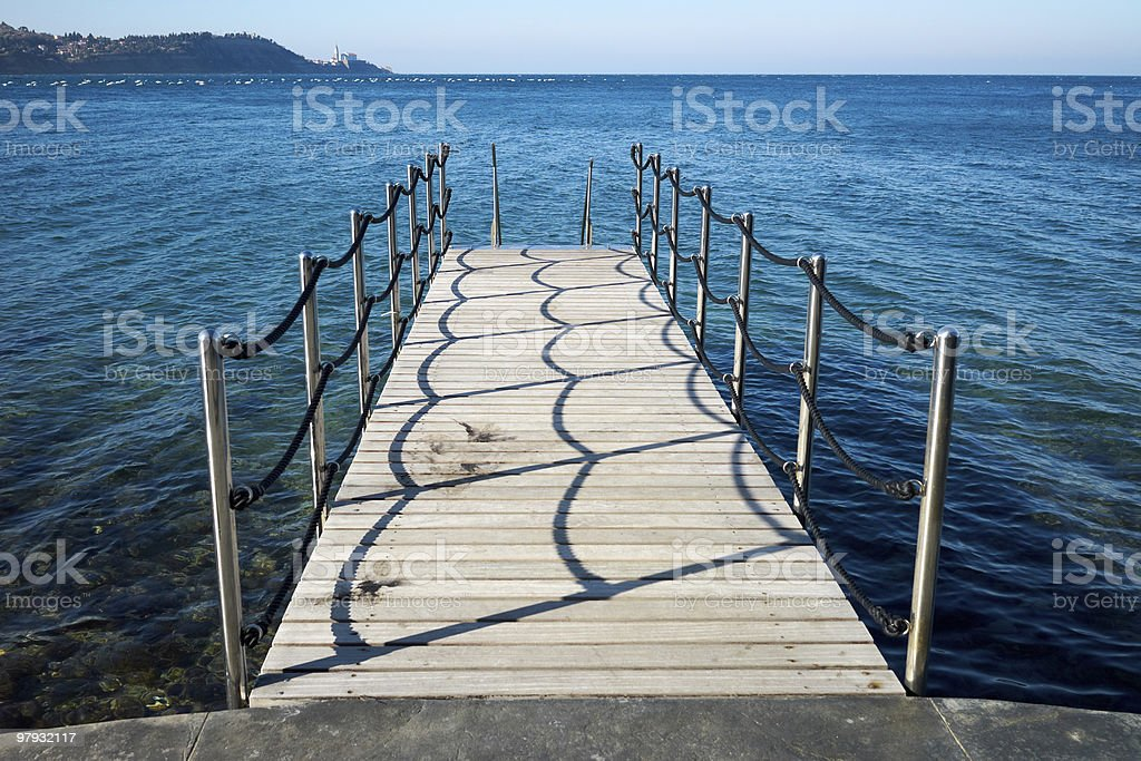 Wooden pier to a sea royalty-free stock photo