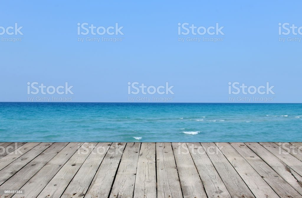 Wooden pier with lake and blue sky royalty-free stock photo