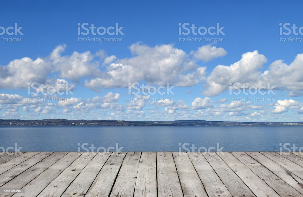 Wooden pier with lake and sky royalty-free stock photo