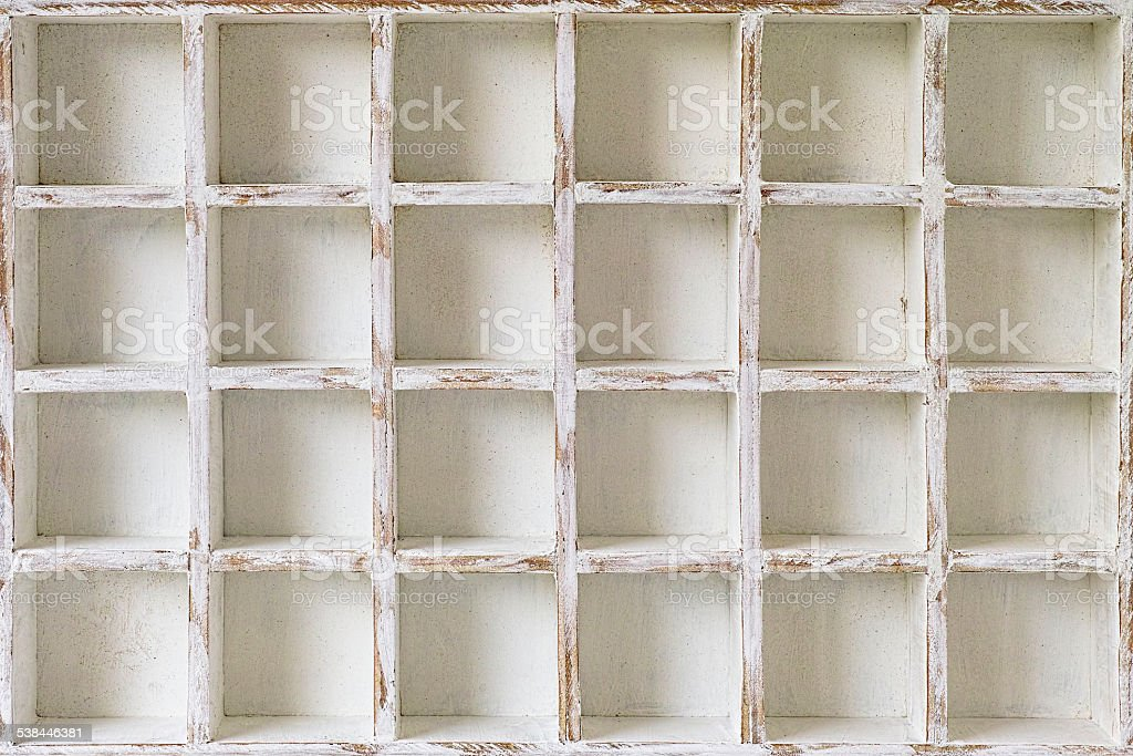 Wooden pigeon holes for storage on a wall. stock photo