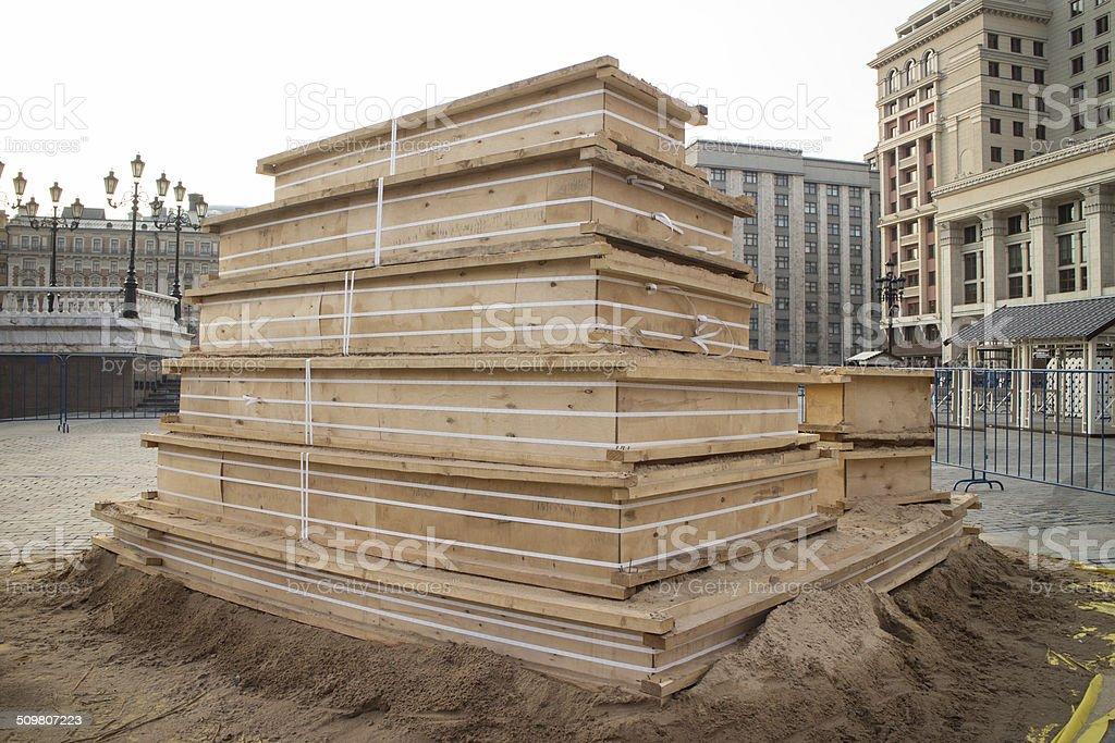 wooden piles on a pallet, used at the construction site stock photo