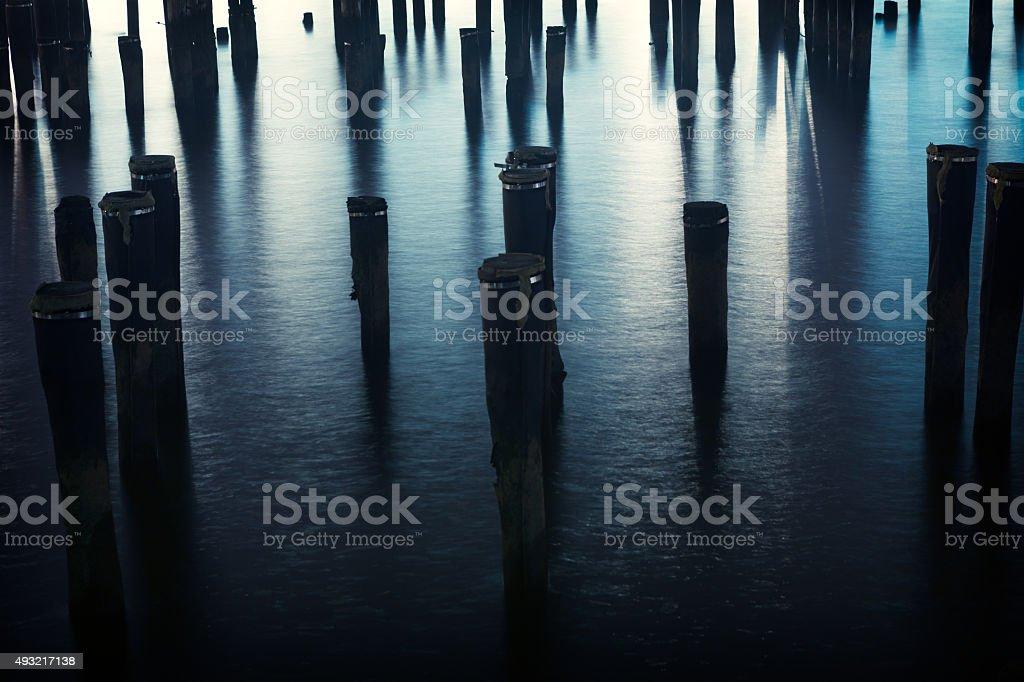 Wooden piles stock photo