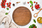 Wooden pizza board and pizza cooking ingredients