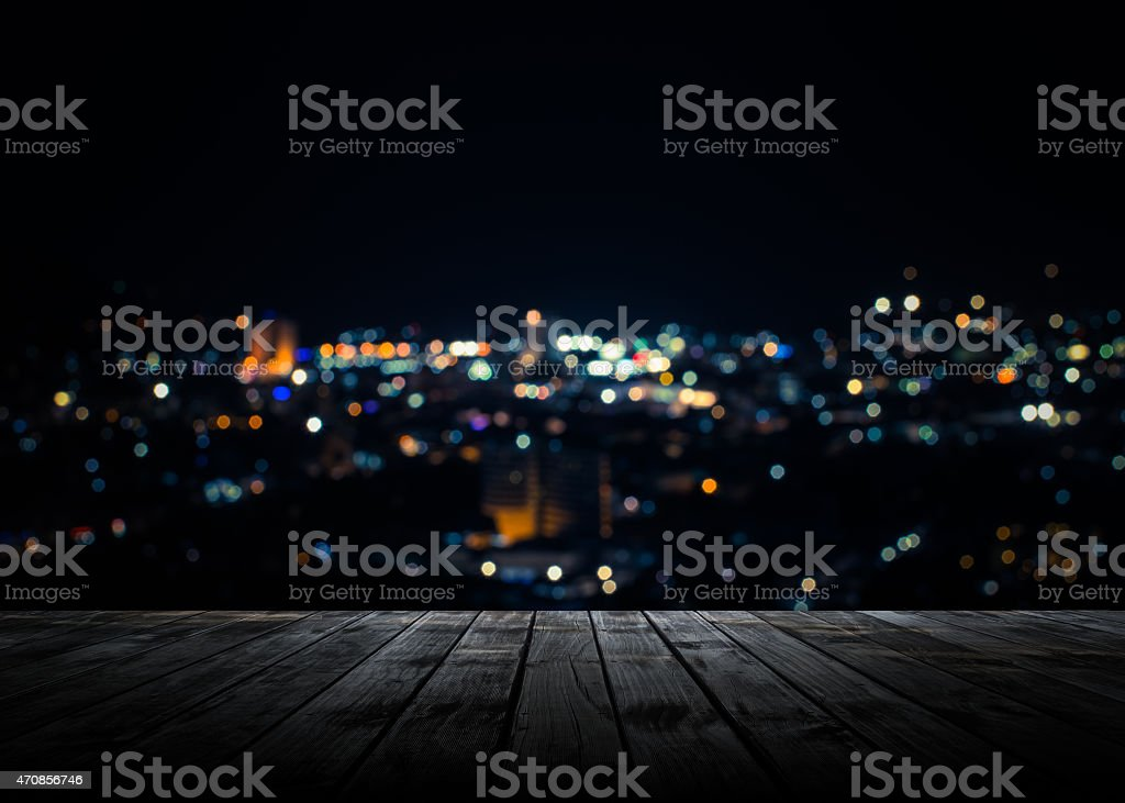 Wooden plank above phuket town at night stock photo