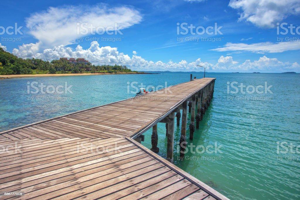 Wooden plank pier bridge with seascape stock photo