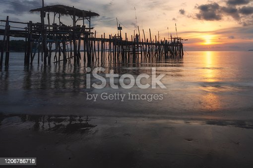 Wooden plank pier with seasacpe and evening sky for relax time at Koh Samet National Park, Rayong Province, Thailand.