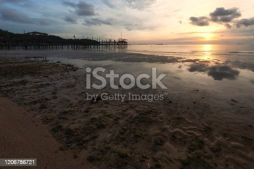 1145124060istockphoto Wooden plank pier with seasacpe and evening sky for relax time at Koh Samet National Park, Rayong Province, Thailand. 1206786721
