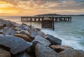 Wooden plank pier with seasacpe and evening sky for relax time at Khao Leam Ya National Park, Rayong Province, Thailand