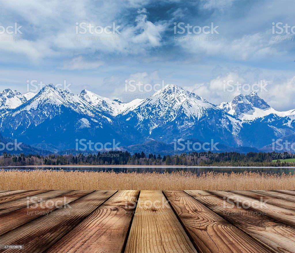 Wooden planks floor with Bavarian Alps landscape stock photo