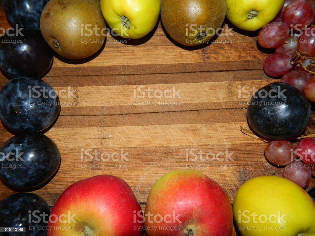 Autumn fruits and berries are located on the perimeter of the kitchen...