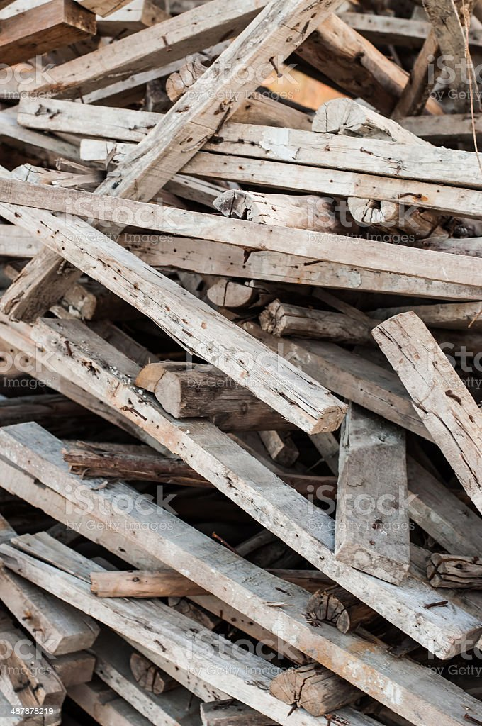 Wooden planks of a demolished house. stock photo