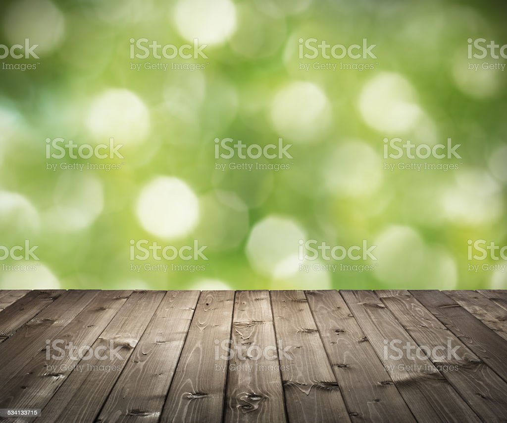 wooden planks on bokeh background stock photo