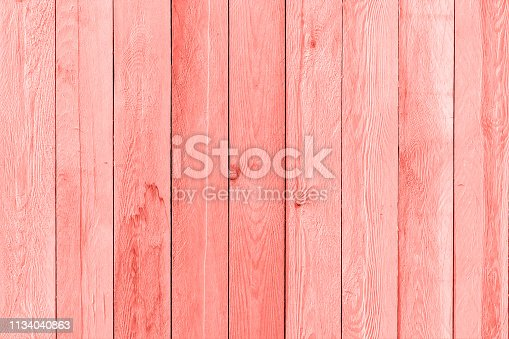 Wooden planks painted trendy coral color of the year 2019, background, texture.