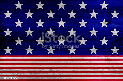 971061452 istock photo wooden planks painted with red and blue stripes and stars 1154078730