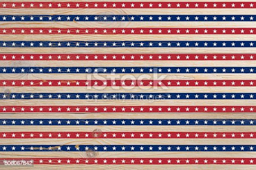 istock wooden planks painted with red and blue stripes and stars 806067842