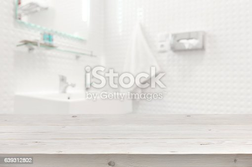 istock Wooden planks surface and blurred bathroom interior as background 639312802