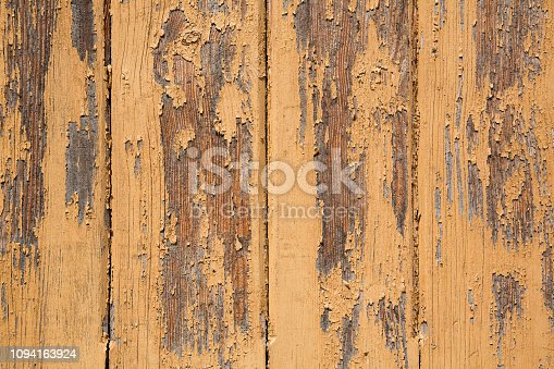Wooden planks with peeling off paint background