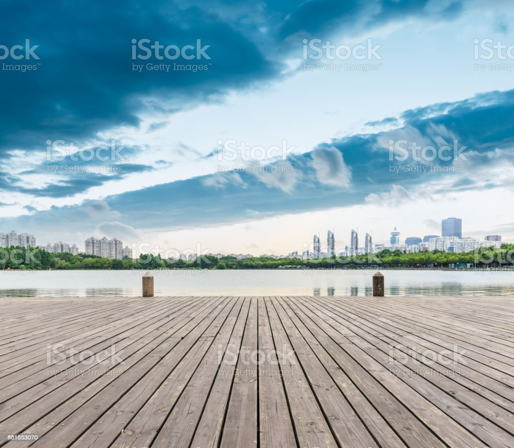 Wooden platform and residential area architectural scenery in Shanghai City Park stock photo