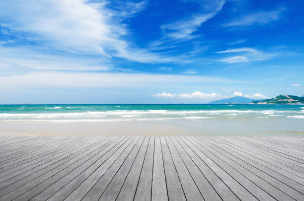 Wooden platform beside tropical beach Wooden platform beside tropical beach boardwalk stock pictures, royalty-free photos & images