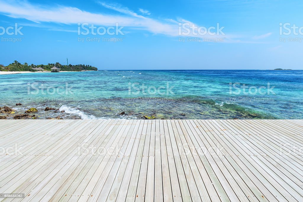 Wooden platform beside tropical green lagoon stock photo