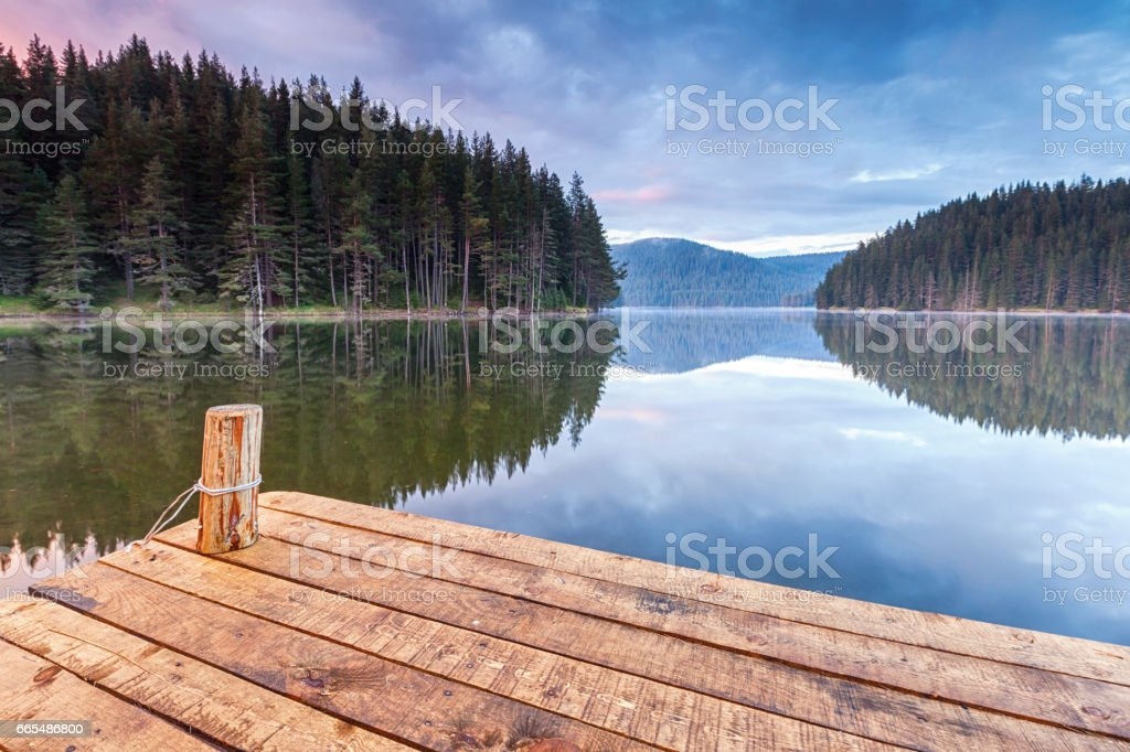 Wooden platform by a lake stock photo