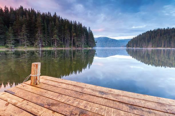 Wooden platform by a lake stock photo