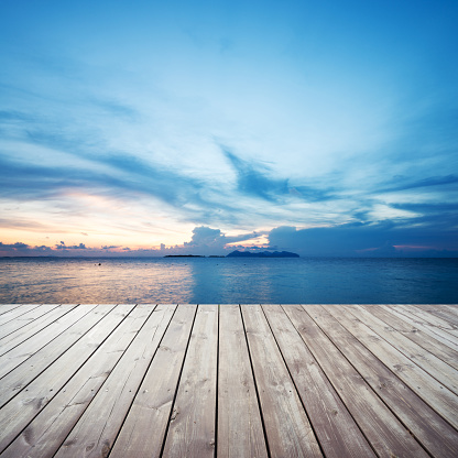 Wooden Platform On Beach With Seascape And Cloudy Sky Stock Photo - Download Image Now