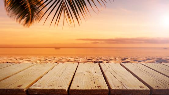 Wooden platform on the sunset beach