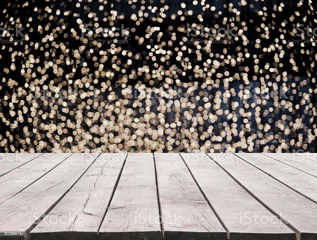 Wooden platform with defocused lights background stock photo