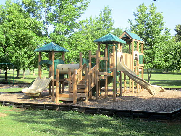 Wooden Playground Equipment in Park stock photo