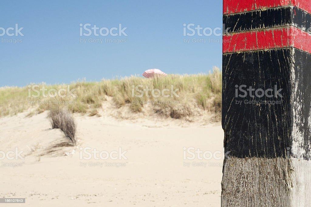 Wooden pole on beach royalty-free stock photo