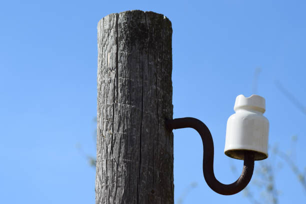 Wooden pole with an insulator stock photo
