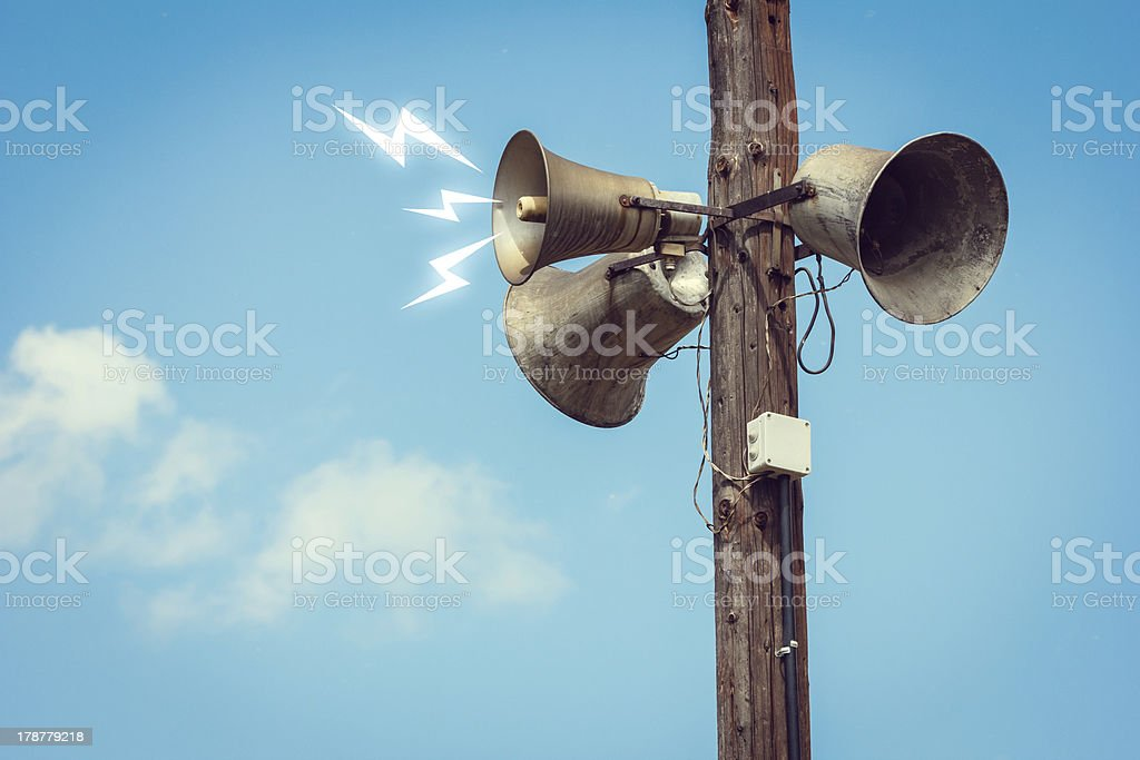 Wooden pole with three speakers royalty-free stock photo