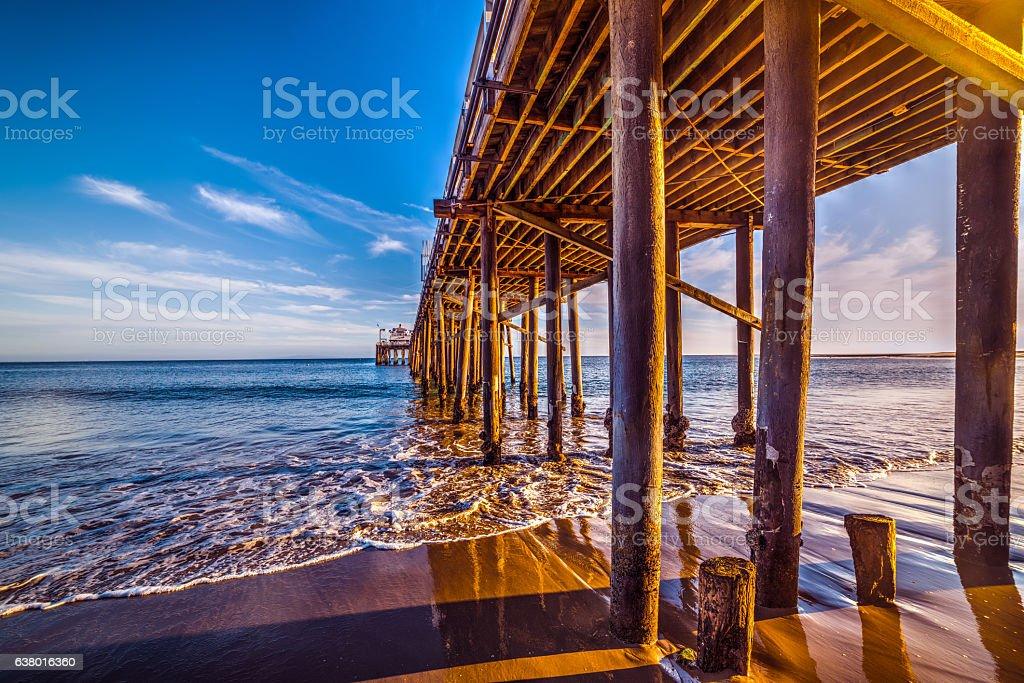 wooden poles in Malibu pier stock photo