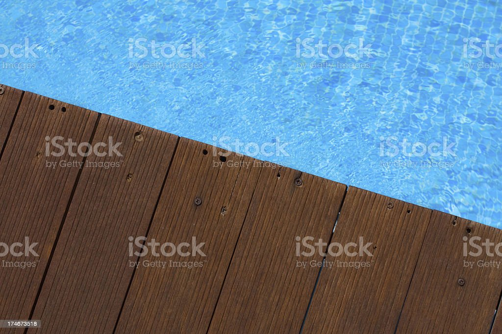 Wooden Pool Deck and Blue Water stock photo