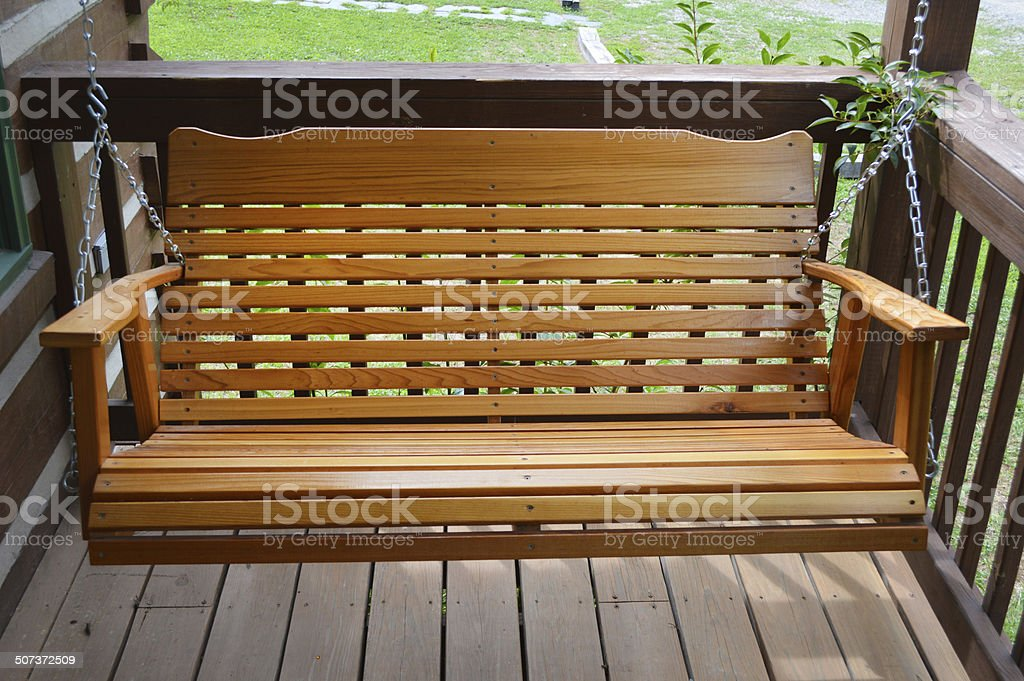 Wooden Porch Bench Swing royalty-free stock photo