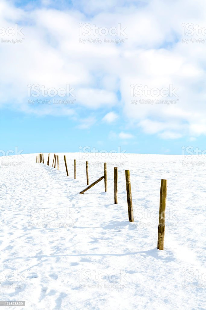 Wooden Posts In The Snow royalty-free stock photo
